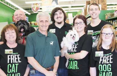 Franchise owner Jeff Bonanni standing with his employees